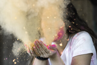 woman-in-white-cap-sleeved-shirt-blowing-dust
